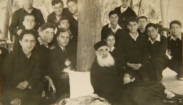 Catholicos Sahag with the students of the Seminary during a relax moment in the orchards of Antelias