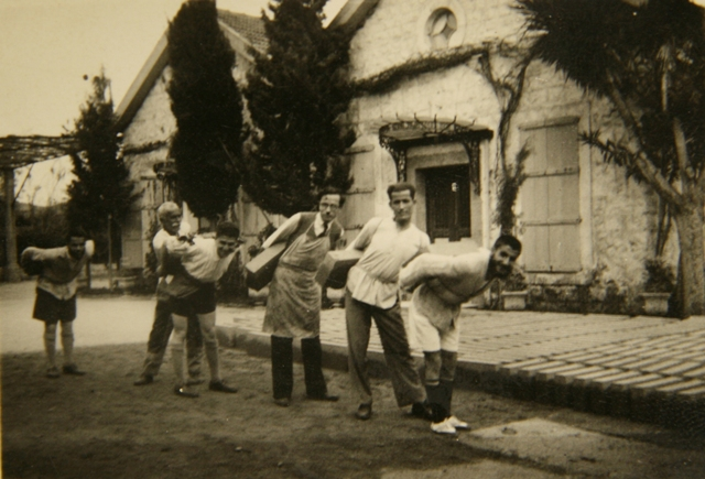 The students assist in the construction of the Cathedral in Antelias by carrying stones in 1934