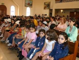 Believers follow the Holy Mass