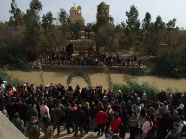 Armenians from both sides of Jordan River meet at the baptism site