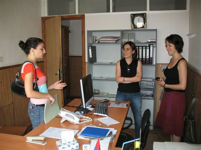 Anoush Tatevossian, executive director of the Armenian Volunteer Corps (AVC), introduces volunteer Katie Riley, a graphic designer and web designer, to her new job placement supervisor, Narine Petrosyan, who directs the Gyumri IT Center.