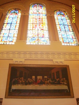 Side windows and picture of the Divine Supper