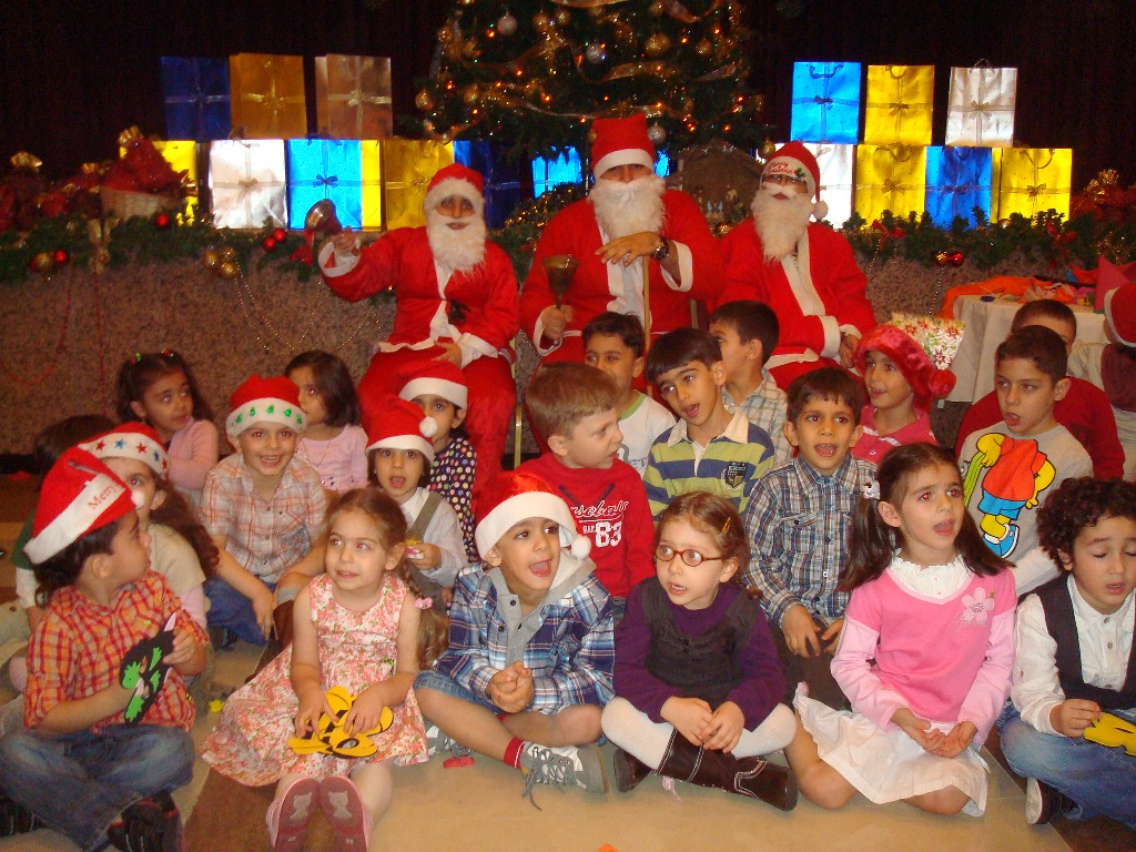 Children surrounding Santa