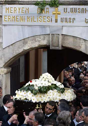 Hrant Dink's coffins is brought out of the Armenian Church on the day of his burial