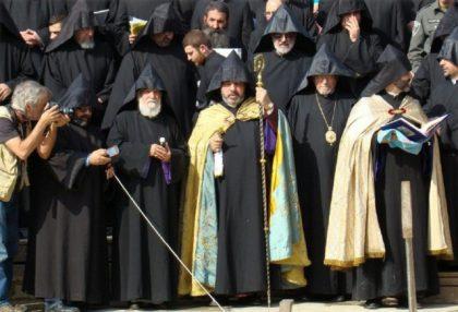 Armenians gather along both banks of Jordan River during traditional baptism ceremony