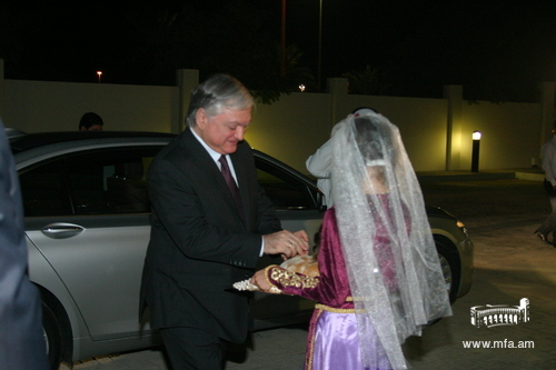 Welcome with traditionally dressed girl