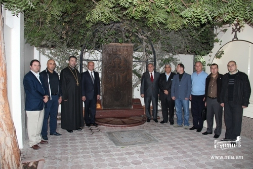 In front of the Armenian Genocide stone-cross monument